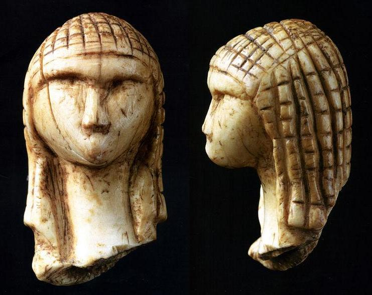 hat/cap,26,000 year old Venus of Brassempouy depicts a woman with a hat, not a hairstyle.