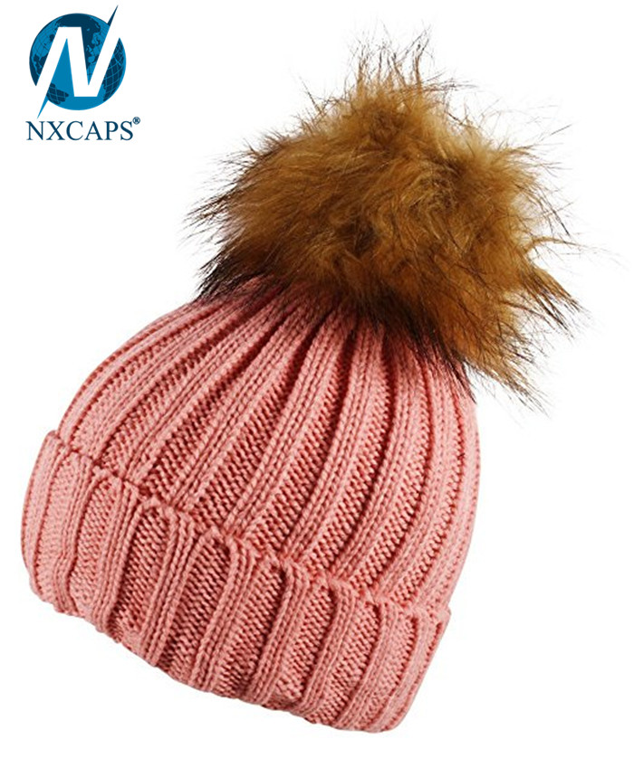 Wholesale plain pom pom beanies winter hat with fur ball beanie,plain pom pom beanies,fur ball beanies,winter hat with two fur balls,pom pom beanie,wholesale beanies,nxcaps shenzhen Fashion company